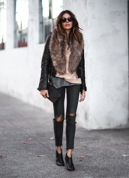 A faux fur collar or stole is the perfect way to add some edge and glamour to your everyday look! Erica Hoida looks utterly glam in this outfit, consisting of distressed black denim jeans, a classic leather jacket, and a faux fur stole. Shrug/Shoes/Clutch: Sole Society, Jacket: DSquared2, Sweater: T by Alexander Wang, Tee: Current Elliott, Jeans: Rag & Bone, Choker: Parpala Jewelry.