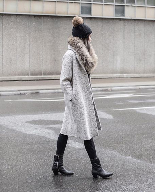 Victoria H is utterly elegant in this faux fur stole, worn with a grey overcoat for that glamorous, classic style. Pair a similar outfit with leather ankle boots to capture these glammy vibes!   Hat: Rudsak.