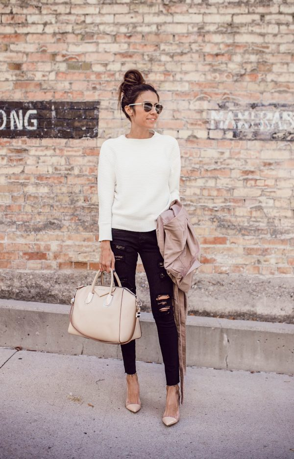 Christine Andrew creates a simplistic, chic style here by pairing a white cable knit sweater with distressed black jeans. A style such as this is ideal for everyday wear, as it is achievable and adaptable. Jeans/Sweater: A.G Jeans.