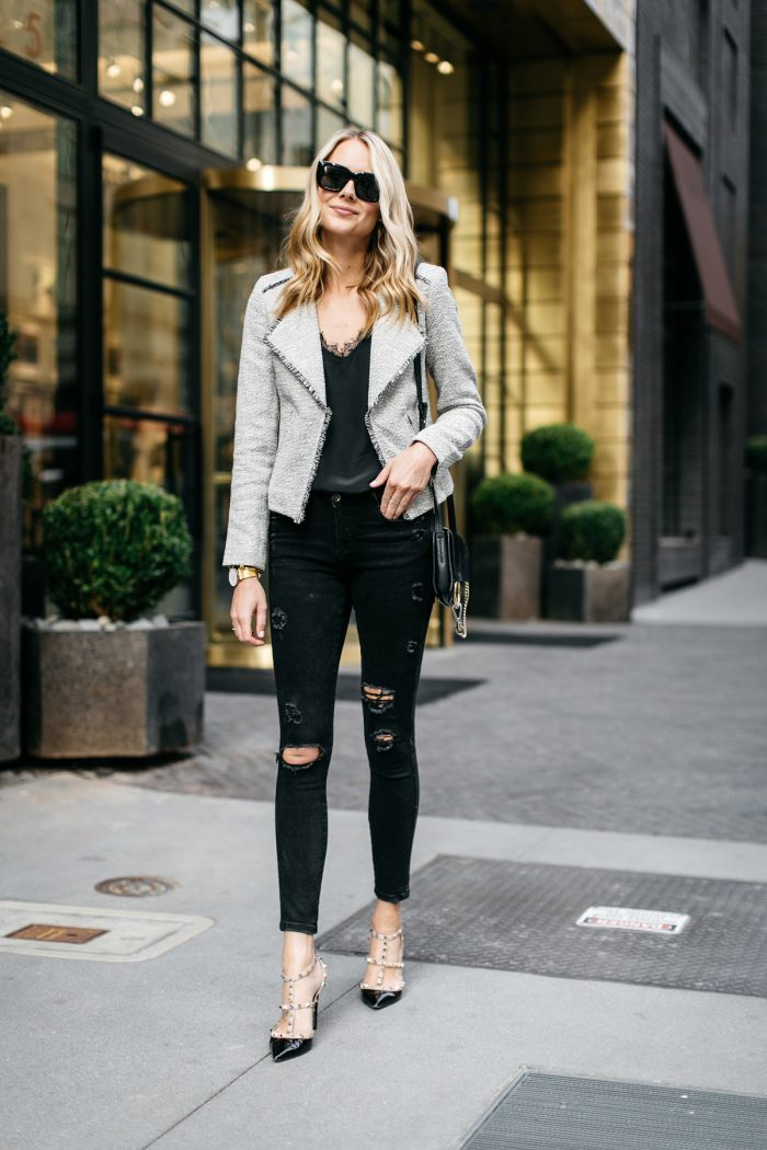 Amy Jackson wears a pair of distressed black jeans with a laced v neck top and a gorgeous grey shearling jacket to create this sophisticated style; finishing the look with a pair of strappy heels which we adore! Black jeans are the staple to any wardrobe, and worn in this style they are always trendy. Jacket: Loft, Tank: Anine Bing, Jeans: Zara, Heels: Valentino, Handbag: Chloe.