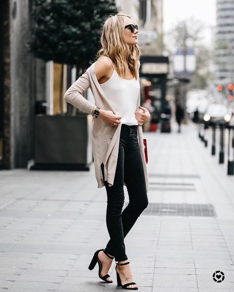 Amy Jackson wears black skinny jeans with stilettos and a plain vest to create a simplistic, flattering style. Wear a long cardigan over this style and take inspiration from Amy! Vest: Club Monaco.