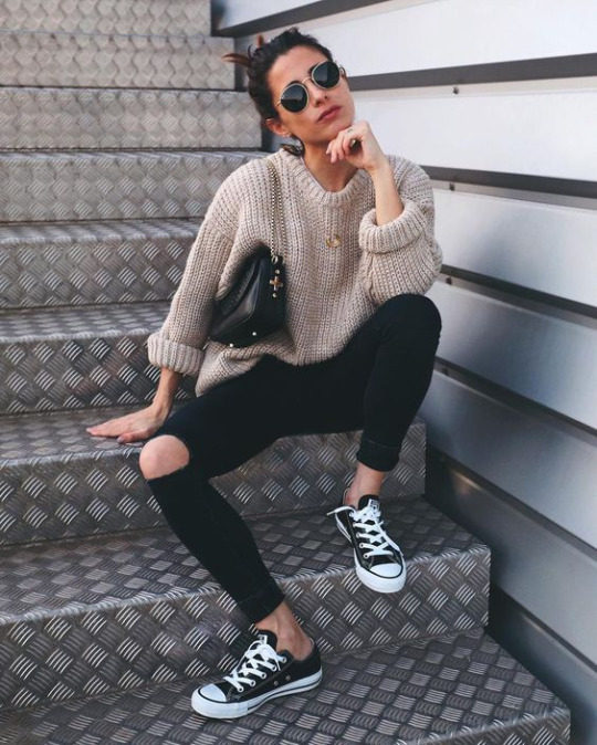 7491be73dc7 Maria Valdes is seen pairing black ripped jeans with a chunky knitted  sweater