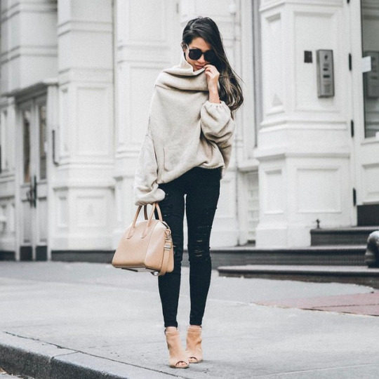 Wendy Nguyen is seen in an oversized beige sweater, designed to be baggy; the perfect match to these skinny black jeans. Wendy finishes the look with beige heeled boots and a matching leather handbag. Brands not specified.