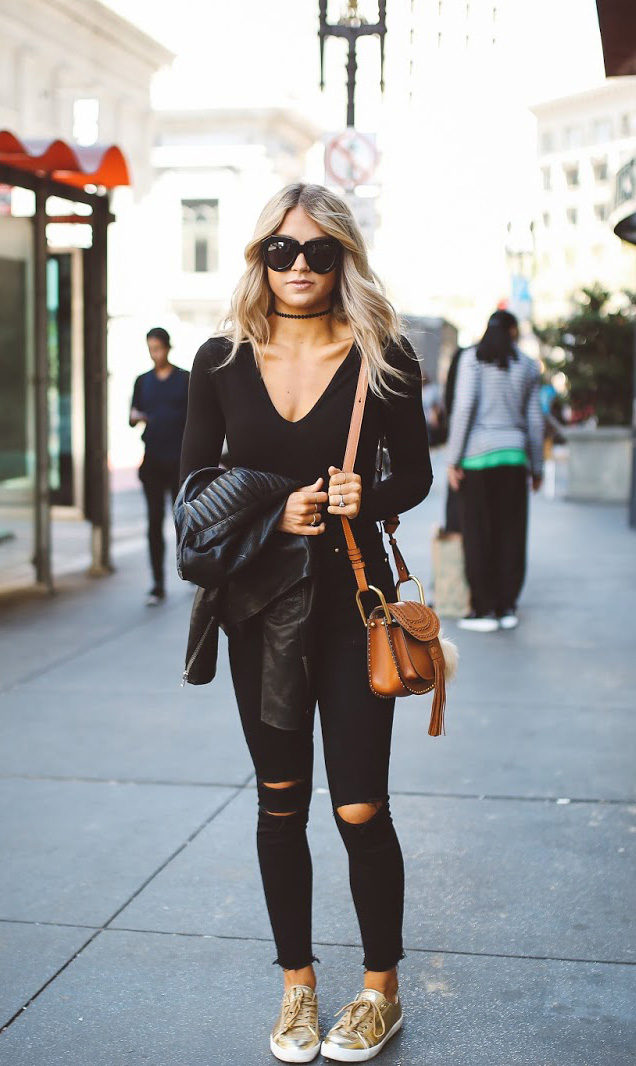 You can simply not go wrong in an all black outfit. Pair black jeans with sneakers and a plunge neck top to get Cara Loren's casual but effective street style. Top: Forever21, Jeans: Shopbop.