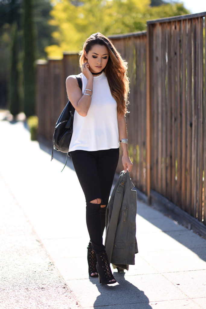 Black jeans will provide the ultimate contrast to a white top. Wear the two together to get a striking and fierce daily look which is both achievable and affordable! Via Jessica R.  Jacket/Shoes: Charlotte Russe, Top: Urban Outfitter, Jeans: Topshop, Bag: Rebecca Minkoff.
