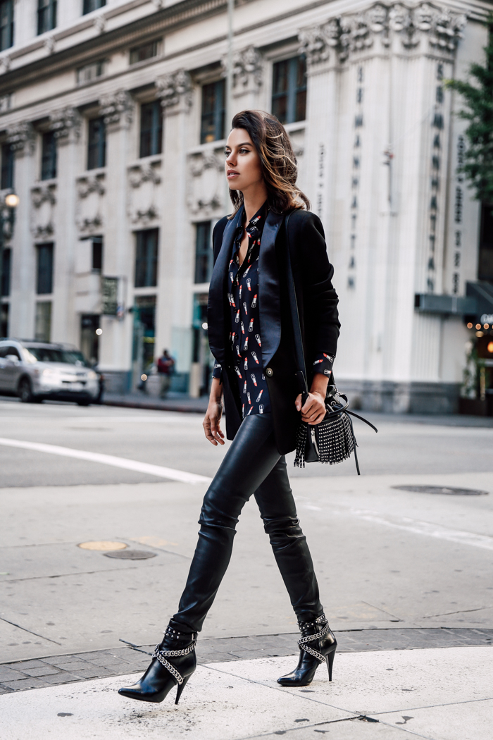 Annabelle Fleur is rocking these totally badass embellished leather ankle boots, pairing them with matching leather leggings and a cute kooky Saint Laurent blouse. Blouse/Bag/Boots: Saint Laurent, Leggings: Express Edition, Jacket: IRO Shera.