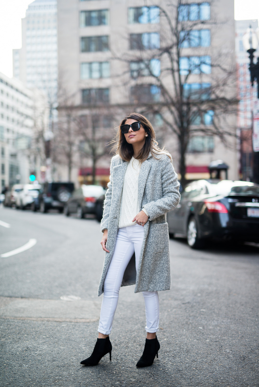 Pastel colours are in this season! Pam Hetlinger is a vision of winter freshness in this outfit, consisting of a cream knit sweater, pale blue jeans, and a fuzzy grey overcoat. Coat: Zac Posen, Boots: Rachel Zoe, Jeans: Frame.