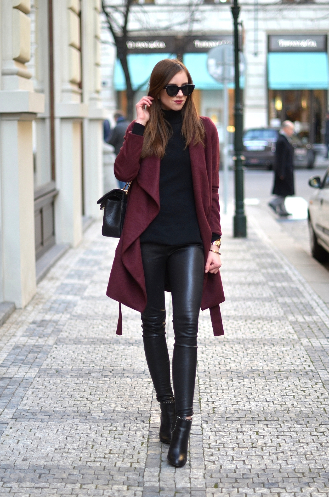 Try reworking colour into an all black outfit by choosing a calm autumnal colour on your coat or scarf. Barbora Ondrackova wears this gorgeous plum number over leather leggings and a simple roll neck sweater; an awesome winter style Coat: Medicine, Top/Leggings: Gasmy, Boots: Givenchy, Bag: Chanel.
