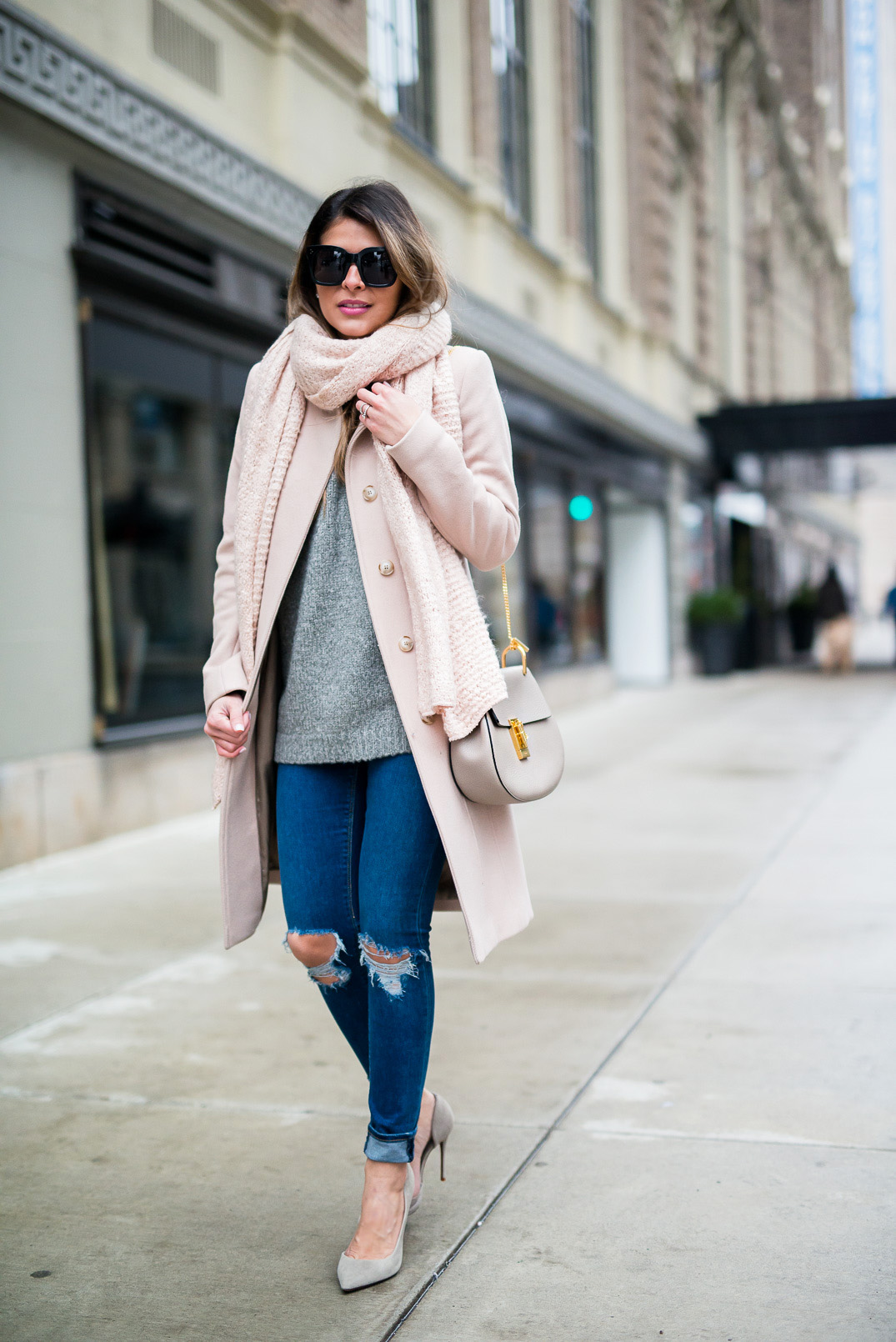 Pastel pink is a trend this winter! Pam Hetlinger rocks this pale rose coat and matching scarf; pairing the two with simple distressed denim jeans and pastel coloured heels. Coat: Reiss, Sweater:Nordstrom, Jeans: Asos, Shoes: Barneys.
