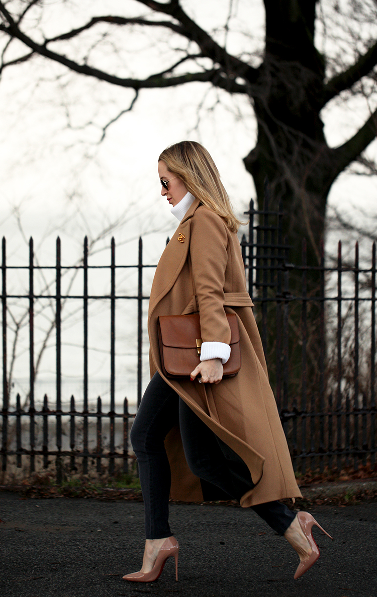Helena Glazer demonstrates exactly how you should be wearing the camel coat trend in this utterly sophisticated outfit consisting of black jeans, nude heels, and a flowing camel coat from Mackage. We love this look! Coat: Mackage, Sweater: Revolve, Denim: James Jeans, Shoes: Louboutin, Bag: Celine.
