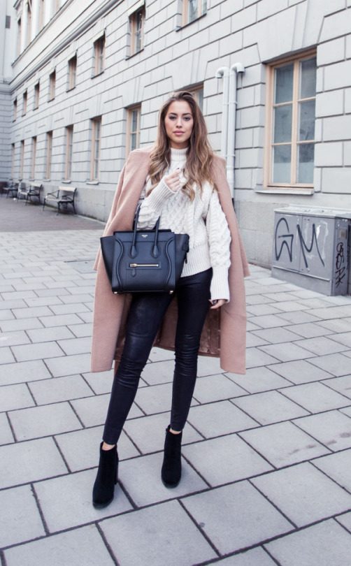 Leather trousers are a year round winner; making a fabulous alternative to jeans with almost any outfit. Kenza Zouiten wears a pair with a gorgeous cream knit sweater and a stylish beige overcoat. Sweater: Zara, Trousers: Ginatricot, Coat: Make Way, Shoes: Jennie-Ellen, Bag: Céline.