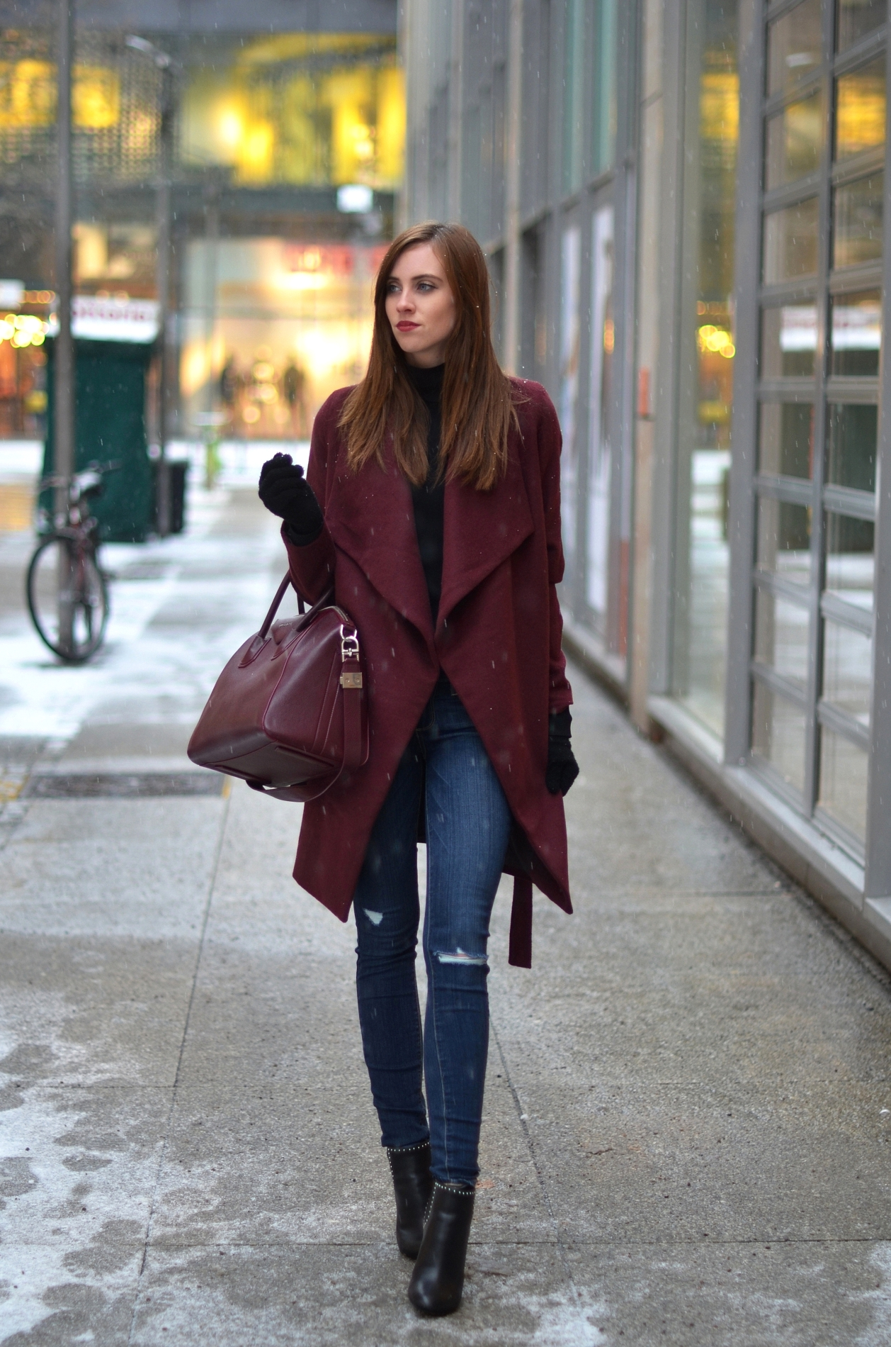 Plum is making a return this season! Barbora Ondrackova looks sophisticated and wintery in this cute plum overcoat, worn with skinny denim jeans and a matching handbag. Coat: Medicine, Turtleneck: Proenza Schouler, Jeans: Paige, Boots/Bag: Givenchy.