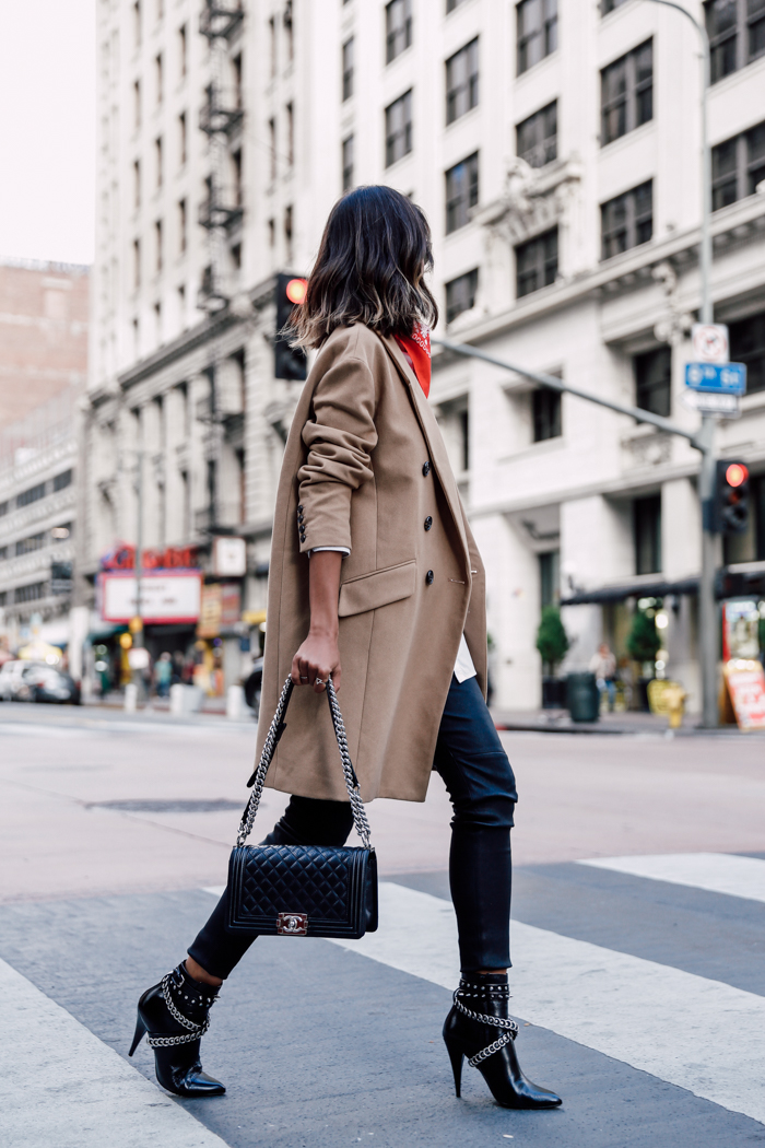 Chain detailed or studded ankle boots are a must have this winter! Not only will they look super edgy as a part of your every day look, but they are also perfect for a night on the town! Via Annabelle Fleur. Coat: Banana Republic, Trousers: IRO, Boots: Saint Laurent, Bag: Chanel.