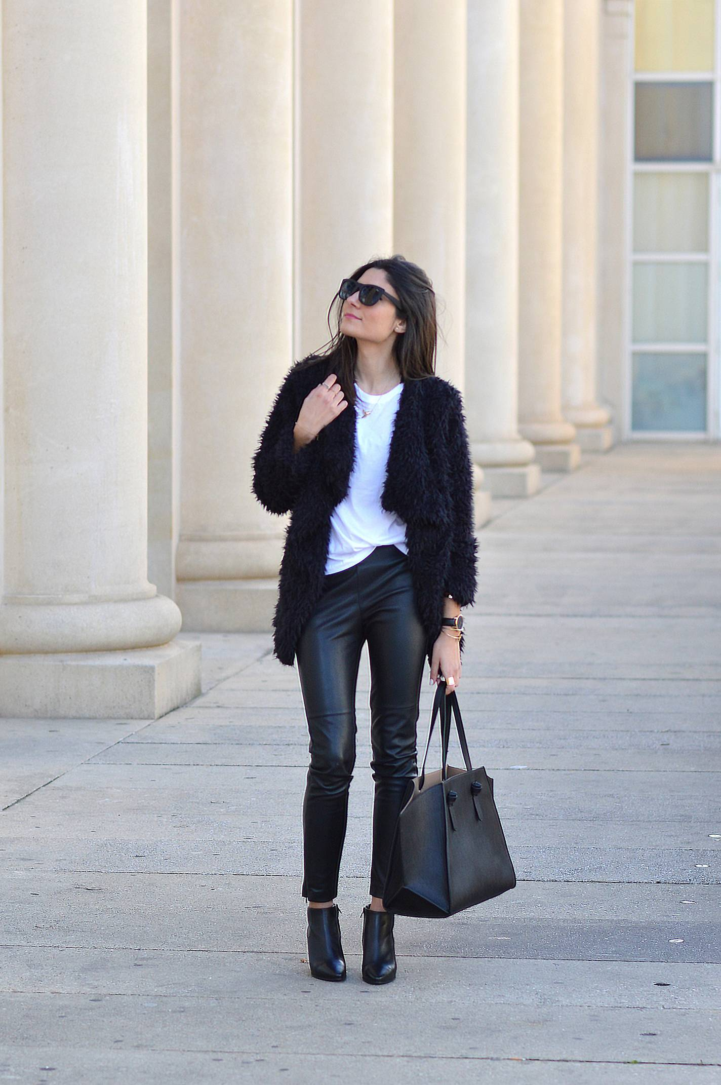 Federica L. is rocking this shaggy faux fur jacket, worn with leather leggings and a plain white tee. Try replicating this style for an easy and achievable cute winter look. Coat: Gold & Silver, T-shirt/Pants/Boots: Zara.