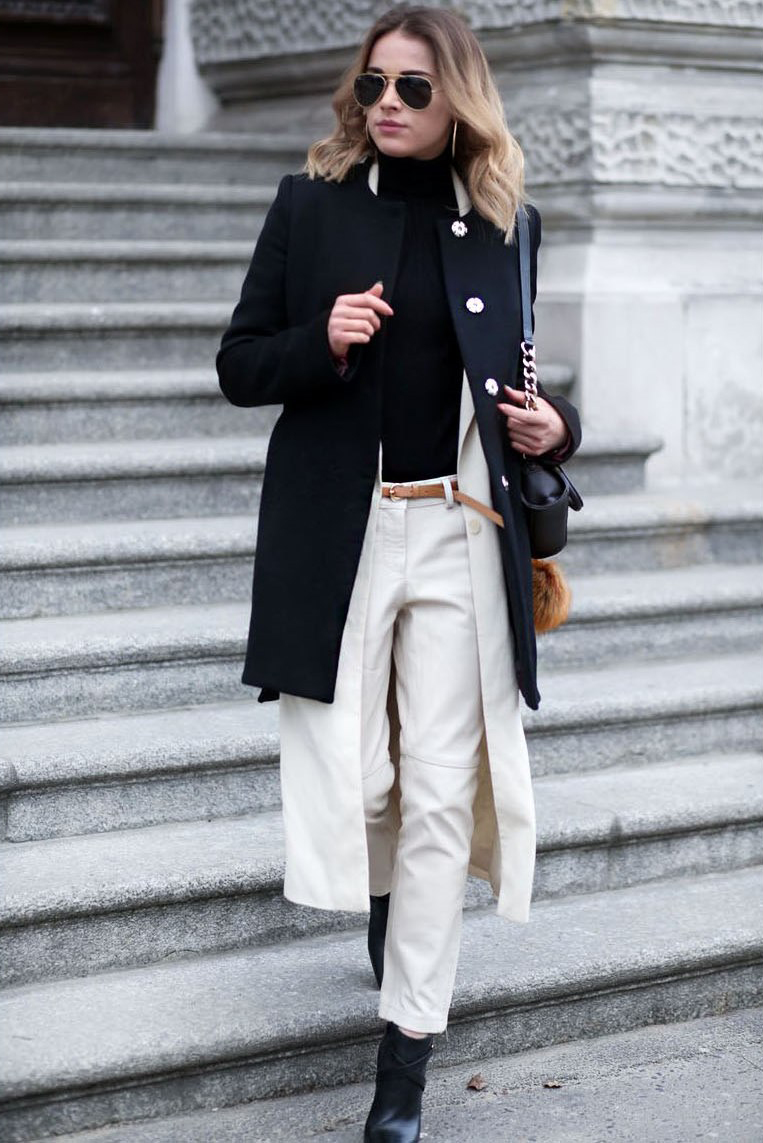 Julietta Kuczyńska looks smart and sophisticated in this navy military style jacket, worn with a pair of pale slacks and a leather mini belt. This look is ideal for more formal occasions, but can work for casual outings too! Coat: Aryton, Trousers: H&M, Shoes: Kazar, Bag: Parfois.