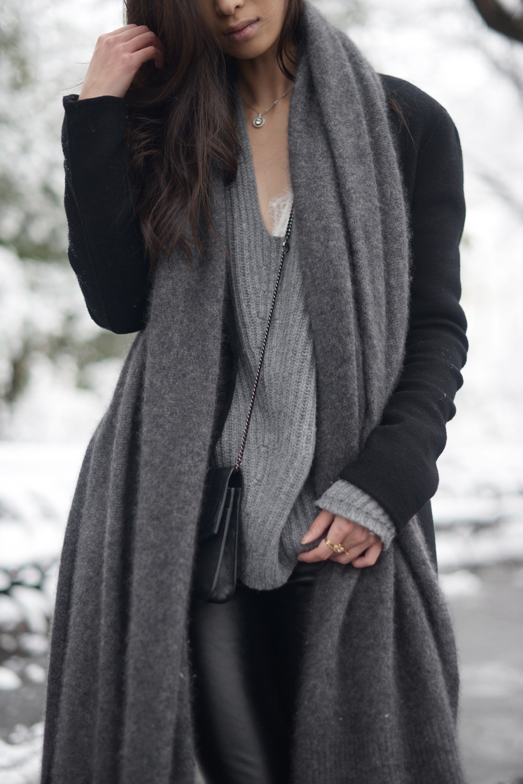 Accessorise your winter outfit with an oversized cashmere scarf and silver jewellery to get Vanny's cute and stylish aesthetic. Keeping the look greyscale will also make it ultra sophisticated. Sweater: Acne, Coat: Alexander Wang, Leggings: David Warner.
