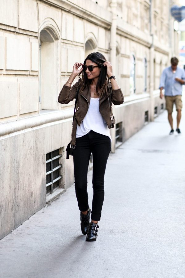 Black jeans are undoubtedly a staple item in every girl's wardrobe. Federica L. styles this pair simply, contrasting the black tone with a plain white tee and a neutral brown suede jacket. Jeans: Cheap Monday, Jacket: Missguided.