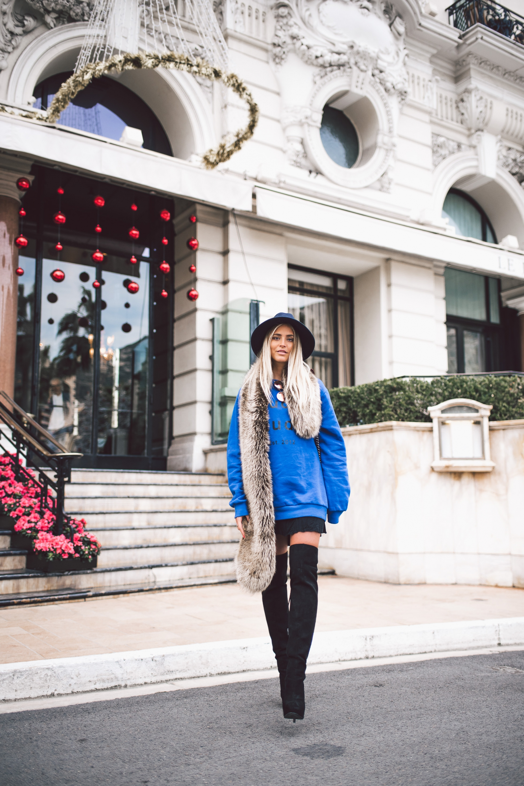 One killer way to style thigh high boots is by wearing them with an oversized graphic print sweater and a statement scarf or faux fur collar like this one, styled by Janni Deler. Hat/Scarf: Primark, Shoes: Janni Shoes. One killer way to style thigh high boots is by wearing them with an oversized graphic print sweater and a statement scarf or faux fur collar like this one, styled by Janni Deler. Hat/Scarf: Primark, Shoes: Janni Shoes.
