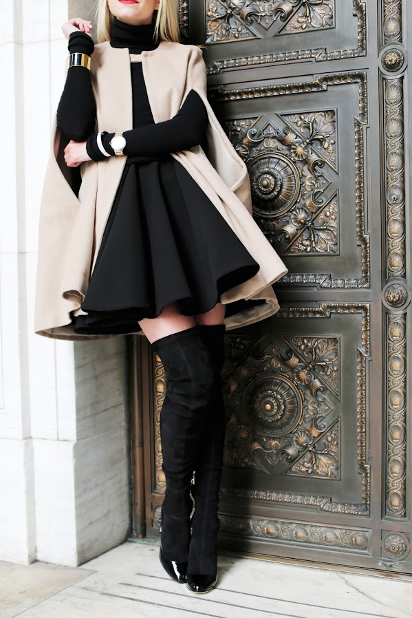 Blair Eadie wears her patent toe thigh high boots with a statement coat for an ultra fancy and unique look. This style will work with or without tights, so try both if you want to vary your outfits day to day! Cape: Old, Boots: Dolce&Gabbana, Hat: Eugenia Kim, Dress: Shopbop.
