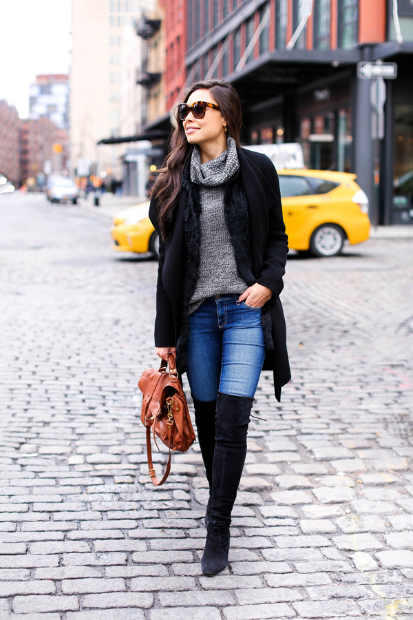 Thigh high boots will also make a fantastic alternative to sneakers or pumps when worn with denim jeans! Kat Tanita demonstrates the effortless style of this look, combining it with a turtleneck and chic black coat. Coat: Joseph, Sweater: Joe Fresh, Vest: Love Token, Jeans: AG, Boots: Stuart Weitzman, Bag: Proenza Schouler.