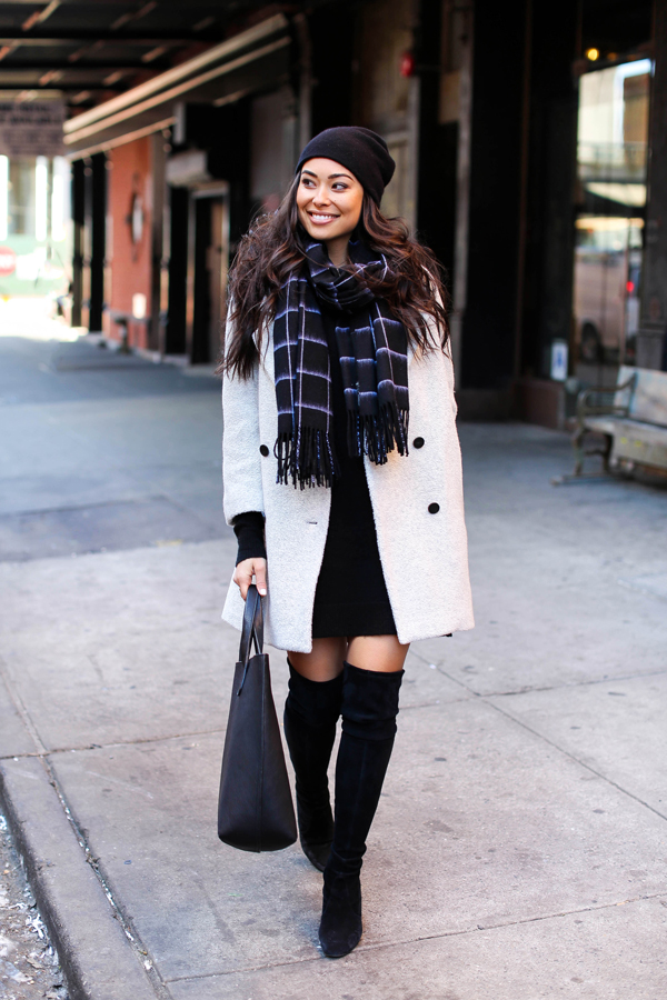 Kat Tanita looks ultra glam in this combination of thigh high boots, a white double breasted coat, and a simple pattered scarf. Add a beanie to keep your look perfectly suited for the winter season. Coat: MiH, Dress: Joe Fresh, Boots: Stuart Weitzman, Scarf: WLFK x GINY.