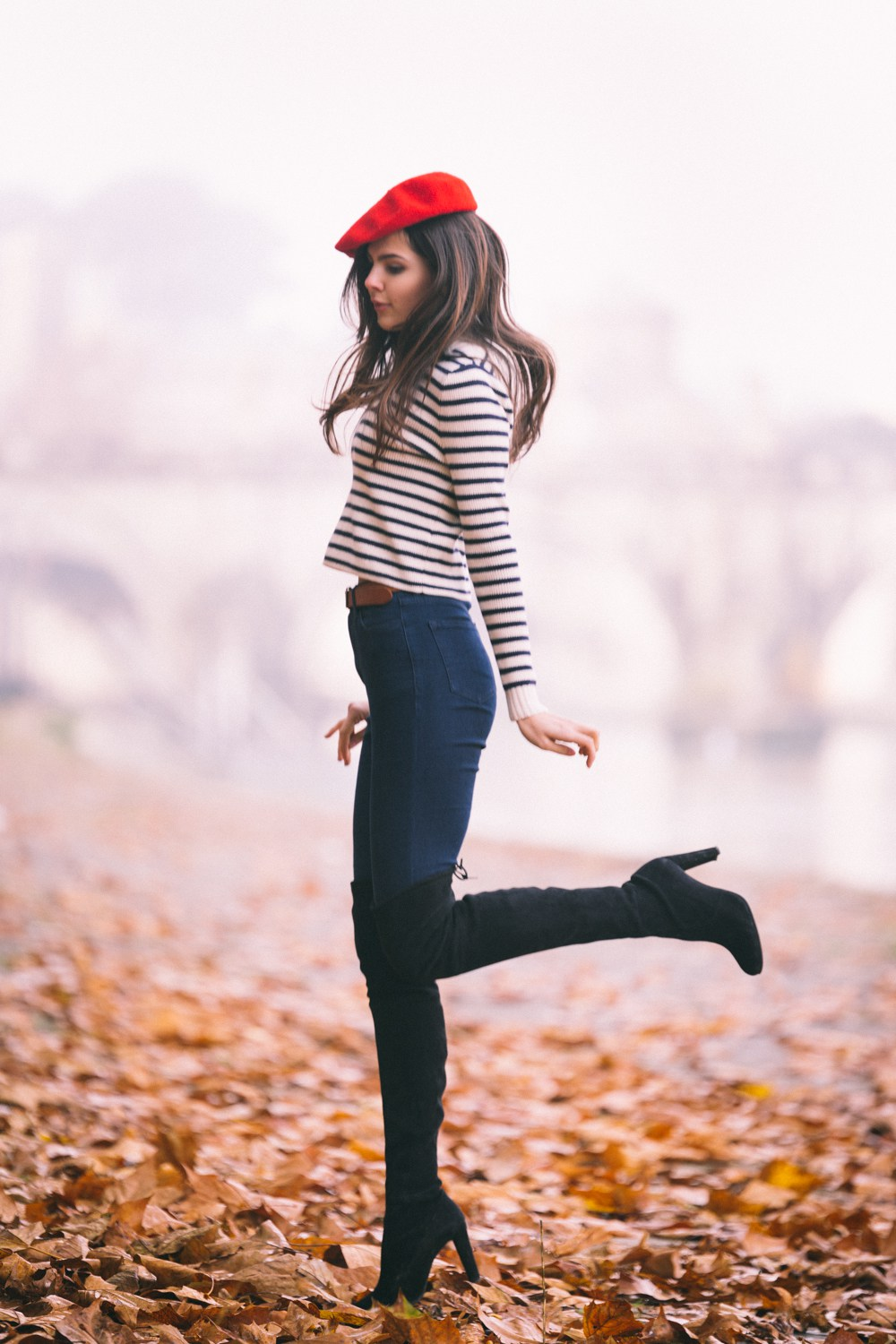 Wear the thigh high boots trend with high waisted denim jeans and a beret to recreate Doina Ciobanu's cute winter look. Outfit: Net-a-porter.