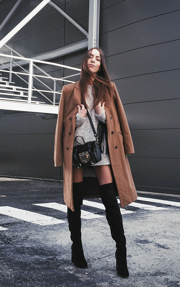 Sofia Reis goes for a sophisticated and elegant aesthetic; pairing thigh high black boots with a cute knit sweater and a broadly styled camel coat. Jacket: Pull & Bear, Knit: Tezenis, Bag: Su-Shi.