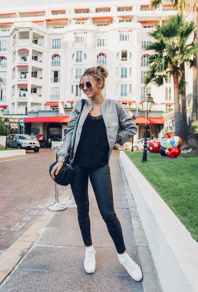 Sendi Skopljak is simplistically glamorous in this casual fall outfit consisting of black jeans and a black vest, paired with white sneakers and a khaki bomber for the ultimate contrast.   Top: Chicy, Bomber Jacket: Nelly, Pants: Missguided, Shoes: Steve Madden,  Bag: Alexander Wang, Sunglasses: Old ones.