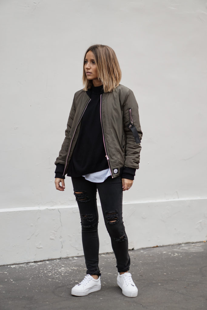 Bomber jackets will ultimately look cool over any outfit. Camille Callen wears this oversized khaki bomber with distressed denim jeans and fresh white Asos sneakers.  Bomber: Sixth June, Top: Pimkie, Jumper: Sheinside, Jeans: Primark, Sneakers: Asos.