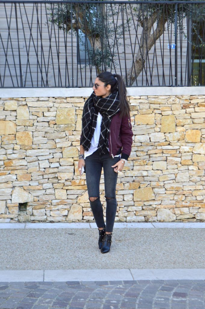 Federica L. shows us how to combine the oversized scarf trend and bomber jacket style; pairing this checked black scarf with a plain white tee and burgundy bomber.   Brands not specified.