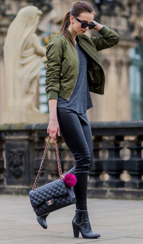 Barbora Ondrackova wears this khaki bomber in a cute and casual style, matched with tight leather trousers and a plain grey tee. This look is easy and affordable; we love it!  Jacket: Topshop, Top: Mango, Leggings: Balenciaga, Boots: Givenchy.