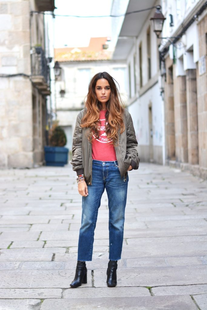A bomber jacket will look great worn with a chilled out, casual outfit such as this one worn by Stella Wants To Die which consists of mom jeans with frayed detailing, ankle boots, and a graphic tee.   Jeans: DIY, Bomber: Last season, Tee: Vans, Boots: Zara.