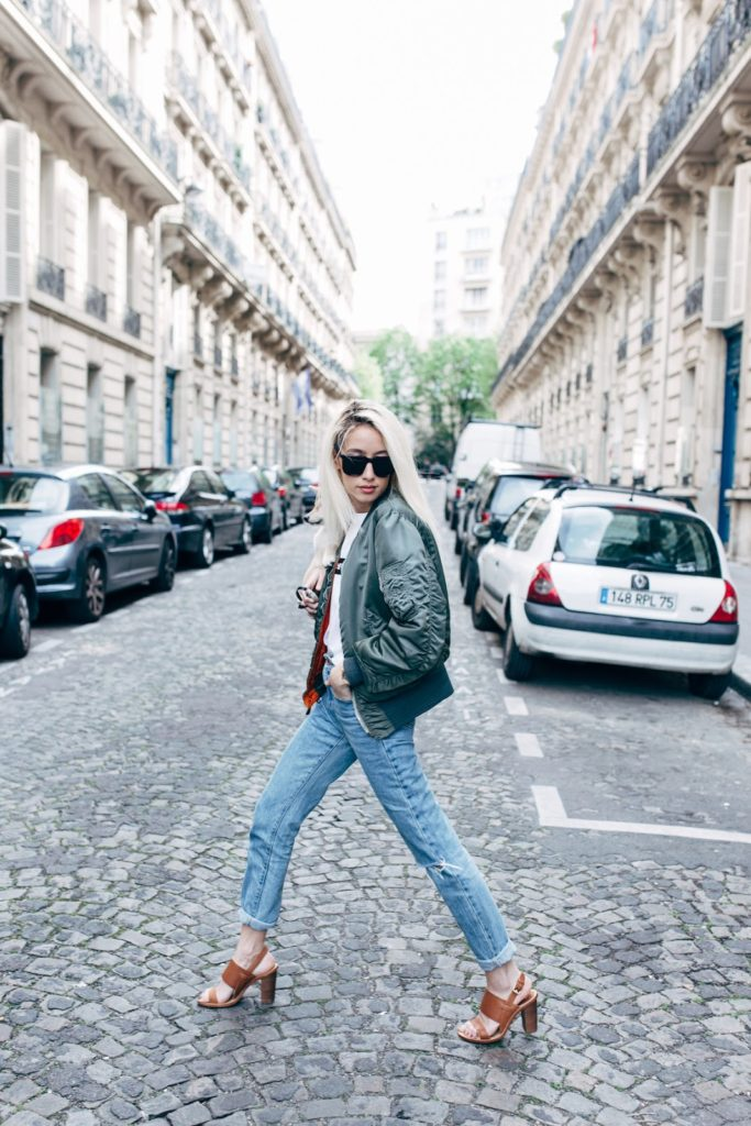 Alexandra Guerain looks cool and edgy in this street wear outfit, consisting of a padded khaki bomber, a Supreme tee, and a pair of high waisted vintage jeans. Wear this look with heels to steal Alexandra's awesome style!   Jacket: Asos, Jeans: The Ragged Priest.