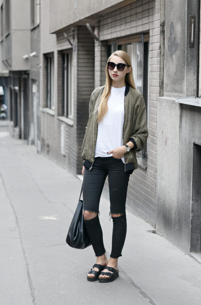 Pavlína Jágrová is wearing a cute khaki bomber with distressed black jeans and platform sandals for an edgy summer look. We recommend this style for a casual look worn with a plain white or black tee.   Jacket/Top: Zara, Jeans/Shoes: Topshop, Bag: Celine.