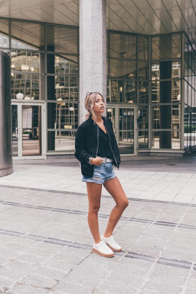 Bomber jackets are a style must-have all year round! Camille Callen pairs this classic black number with a pair of distressed denim shorts to create a gorgeous summer aesthetic which is perfect for every day wear.   Bomber: Missguided.