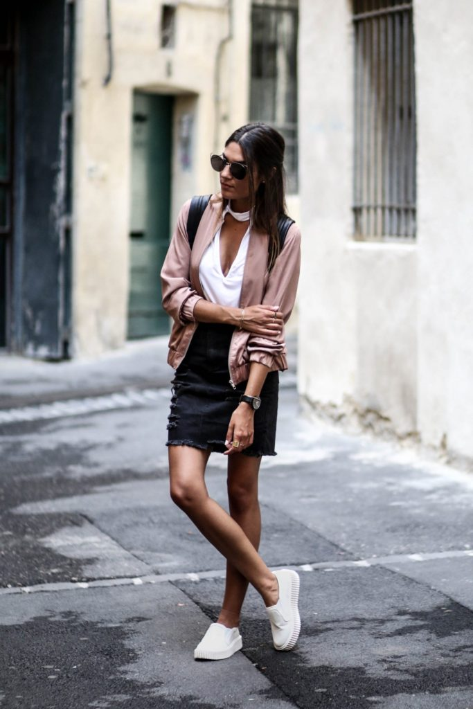 A blush pink bomber such as this is the perfect crossover between edgy and feminine chic. By pairing this piece with a distressed black denim skirt and sneakers, Federica L. has created a gorgeously androgynous look which we love!  Bomber/Skirt: Missguided.