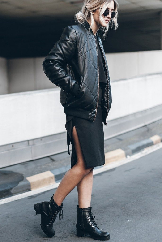 Jacqueline Mikuta shows us how to wear a bomber jacket, pairing this black leather number with a pair of edgy combat boots and a slit detailed pencil skirt creating a totally badass look which we love! Top: The Fifth, Skirt: BNKR, Bomber: Jack & Jones, Bag: Ganni, Belt: Dylan Kain, Boots: Esprit.