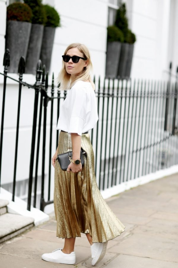 Ever tried wearing a metallic pleated skirt? Jessie Bush shows us exactly how to wear this glitter-perfect style, pairing this skirt with sneakers and a white blouse to keep all the attention where it belongs. Skirt: Farfetch, Tee: Max Mara.