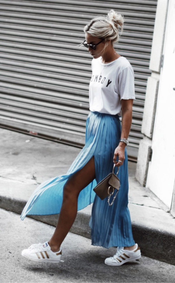 Mary Seng is a vision in this gorgeous pleated skirt from Asos, with slit detailing and in a fabulous shade of pale blue. By pairing this piece with a graphic print tee and a pair of sneakers, Mary has captured the essence of street style! Skirt: Asos, Tee: Tomboy, Trainers: Adidas, Bag: Chloe.