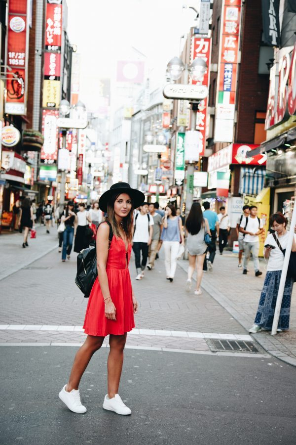 Alexandra Pereira knows exactly how to stand out from the crowd as she stuns us in this gorgeous red summer dress from Majorelle. Pair your own with sneakers and a wide brimmed hat to steal this utterly unmissable style! Dress: Majorelle, Sneakers: Anine Bing, Hat/Backpack: Asos.