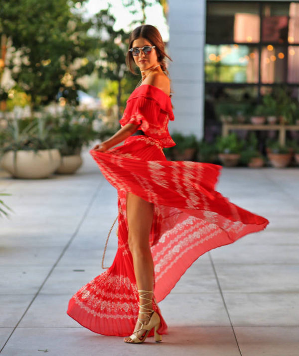 Paola Alberdi is mesmerising in this beautiful maxi dress with intricate pleat detailing. Pair something similar with strappy sandals to capture the essence of Paola's gorgeous style. Dress: Matches Fashion, Bag: Chanel.