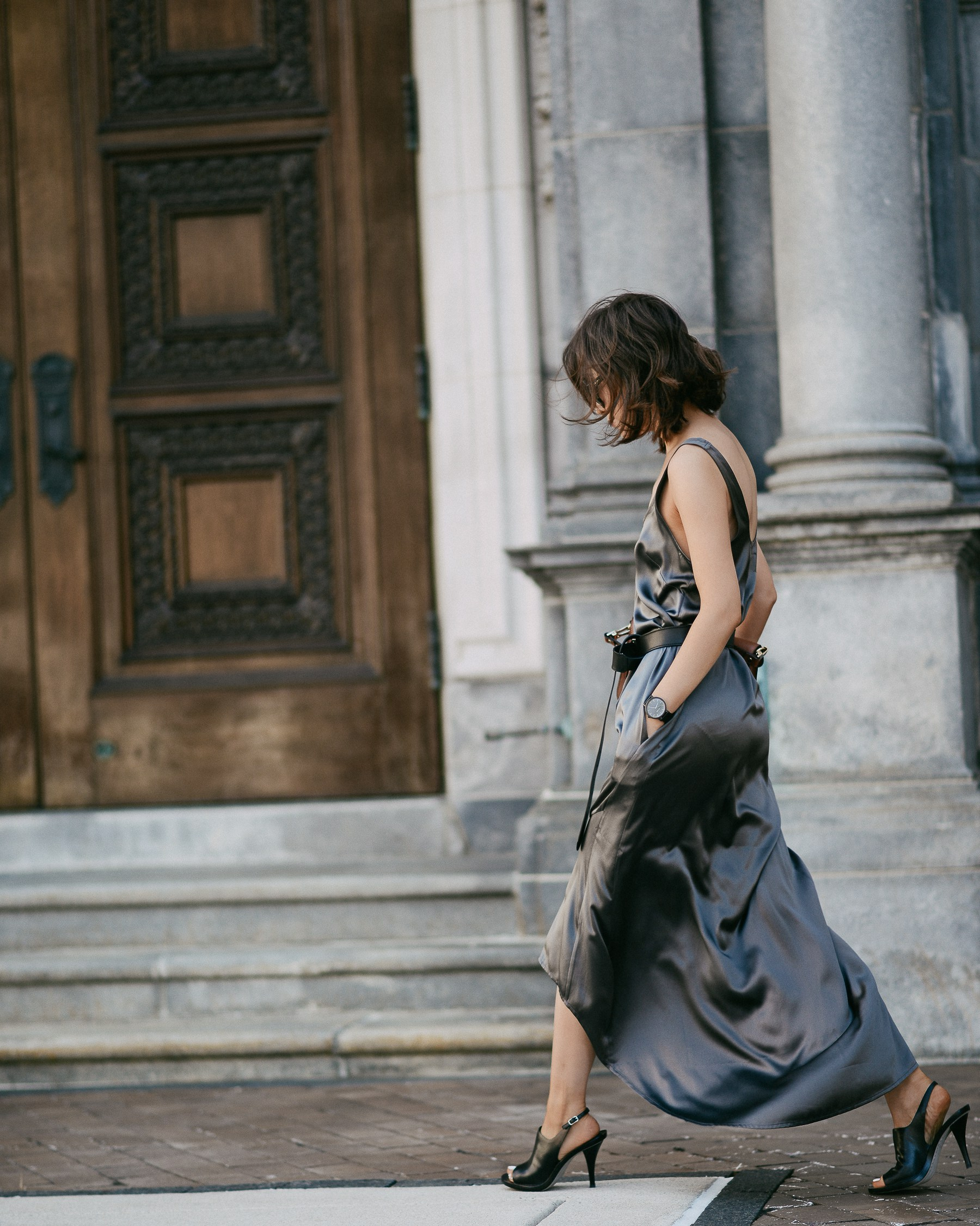 Satin dresses are the hottest new spring trend! Wear yours with a pair of mules and sunglasses to steal this gorgeously sophisticated style which will show off your figure and curves! Via Diana Z Wang. Dress: Brochu Walker, Shoes: Alexandre Wang.