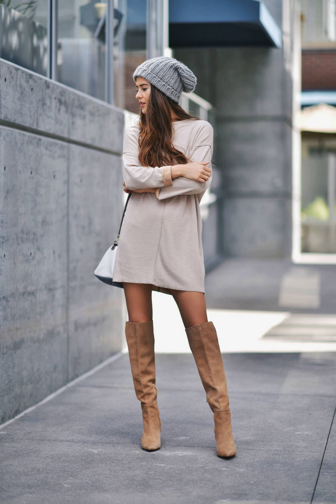 Wearing a simple t-shirt dress with over the knee boots is the perfect way to dress down your everyday spring style while retaining a degree of sopistication. Try this look with a beanie to steal Paola Alberdi's look. Dress: Zara, Shoes: Carolina Herrera.