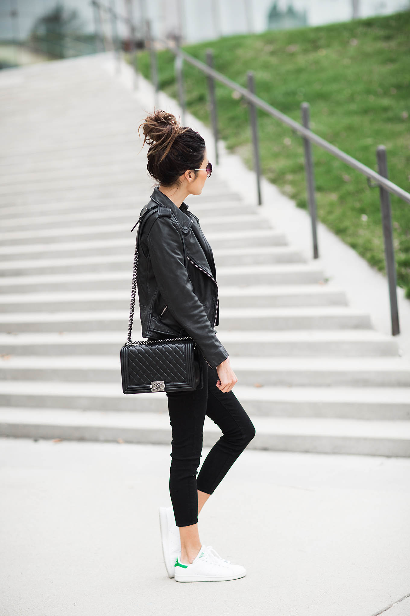 Christine Andrew keeps it simple in an all black outfit consisting of cropped black jeans, a leather jacket, and a cross body quilted leather bag. We suggest wearing an all black outfit if you want to achieve a casual yet sophisticated style. Jacket: All Saints, Jeans: Nordstrom.