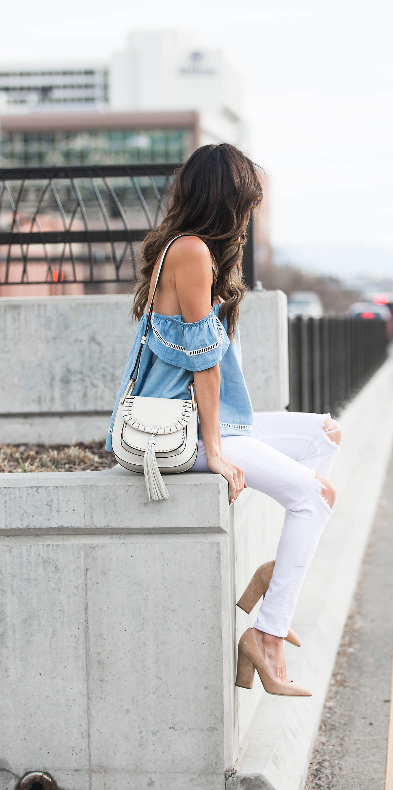The off the shoulder top trend is one which is coming back with a bang this spring! Christine Andrew wears the look on a beautiful embroidered denim top, paired with white jeans - the ultimate spring classic. Top/Jeans: Bloomingdale's, Heels: Intermix.