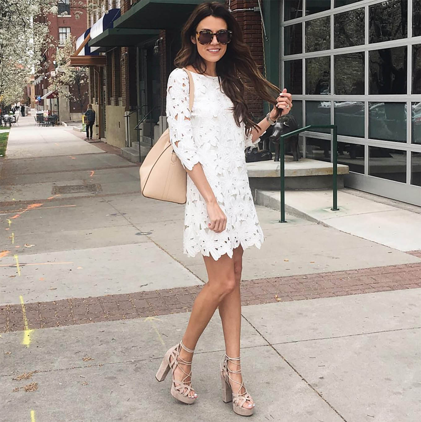 Christine Andrew looks fresh as a daisy in this beautiful white dress with cut away detailing. Matched with strapy nude sandals, this dress creates a gorgeous summery feel which we love! Dress: Nordstrom, Shoes: M Gemi.