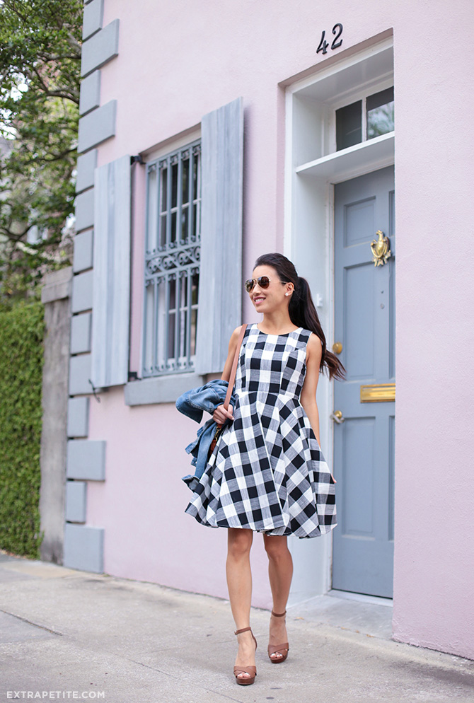 Jean Wang is a vision in gingham! This classic print is a spring essential, and can be worn stylishly on a dress, skirt, or top! We love Jean's simple accessories, nude heels and a brown cross body bag. Dress: Maison Jules, Shoes: WHBM.
