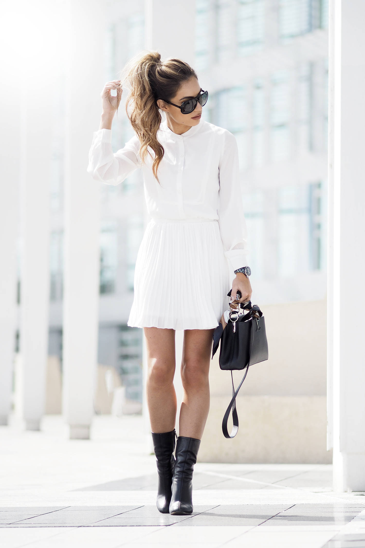 Lydia Lise Millen is a vision in all white glamour! We love this cute pleated mini skirt, worn as part of a dress with a matching white button up shirt and contrasting black ankle boots. A black and white outfit is the way to go for simple sophistication! Dress: Unique21 @ Lipsy, Bag: Louis Vuitton, Scarf: Gucci, Boots: Chloe.