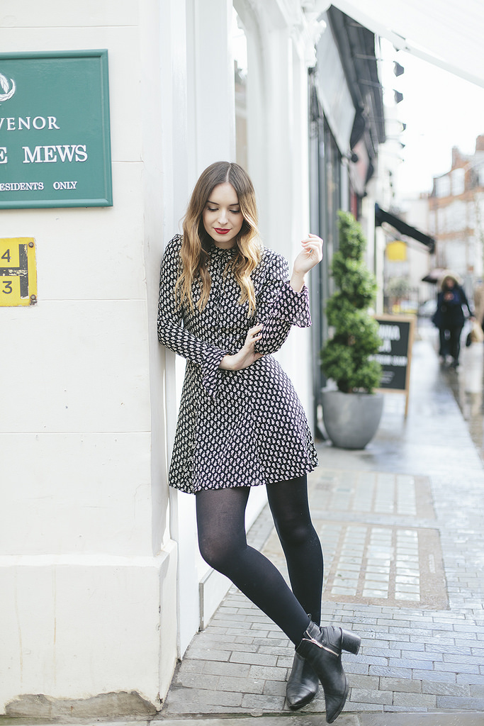 This gorgeous retro style shirt dress is the perfect choice for a fun and feminine spring style! Copy this look with tights and ankle boots or without tights and paired with sandals for a summery feel. Via Olivia Purvis. Dress: Reformation, Boots: Zara, Bag: Lulu Guinness.