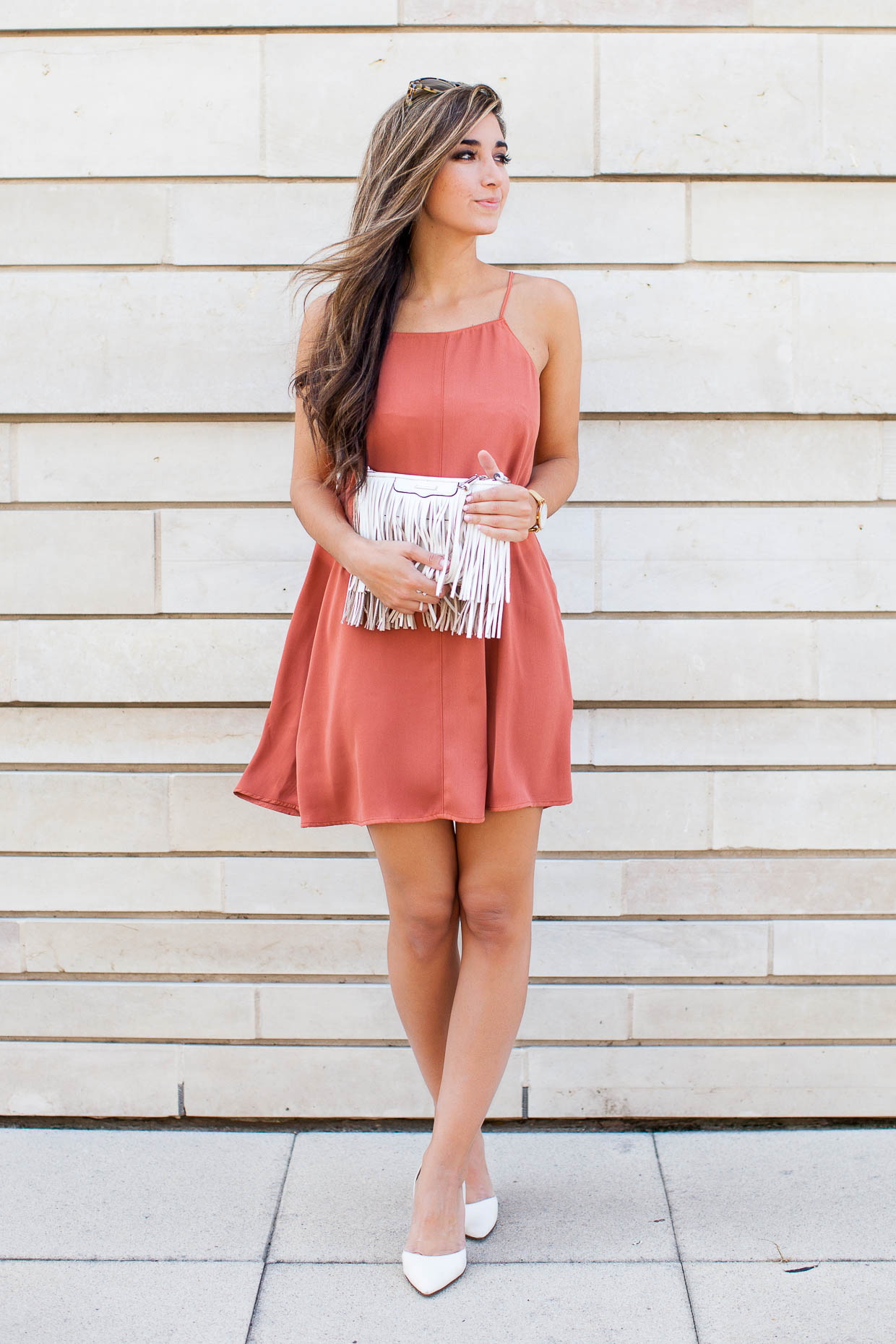 Jessi is a picture in coral, rocking this gorgeously femme mini dress with white sandals and a matching tassled handbag. Perfect for warm spring evenings, we recommend this outfit with either flats or heels! Dress: Nordstrom.